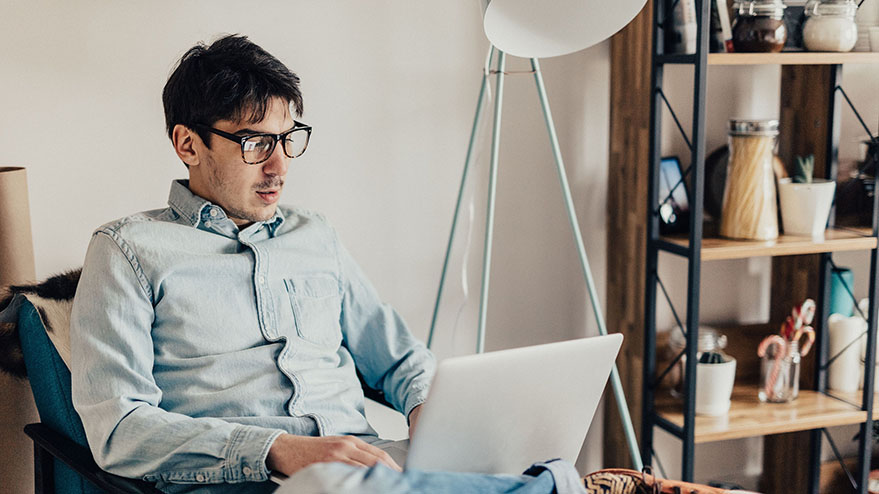 Man-with-glasses-on-laptop