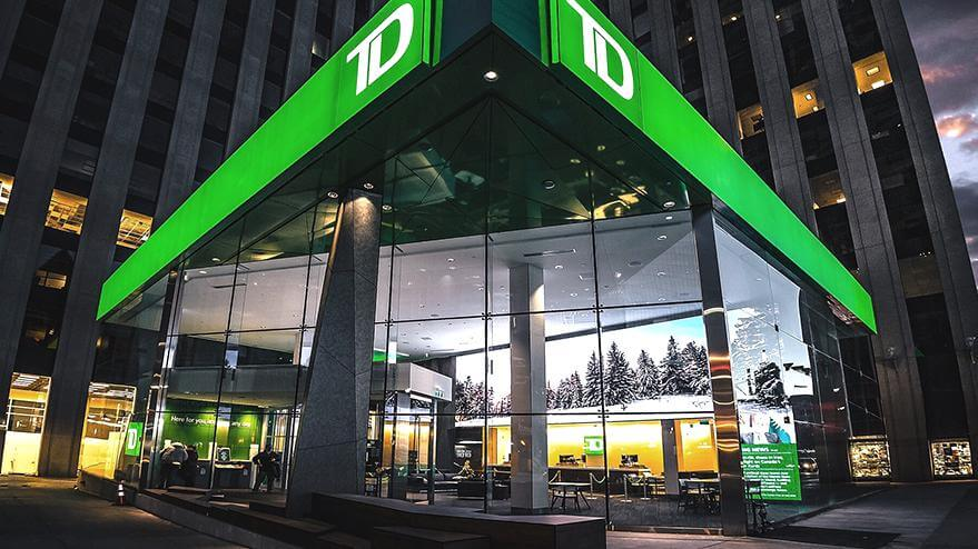 An outside look at one of TD's newly renovated branches at dusk.