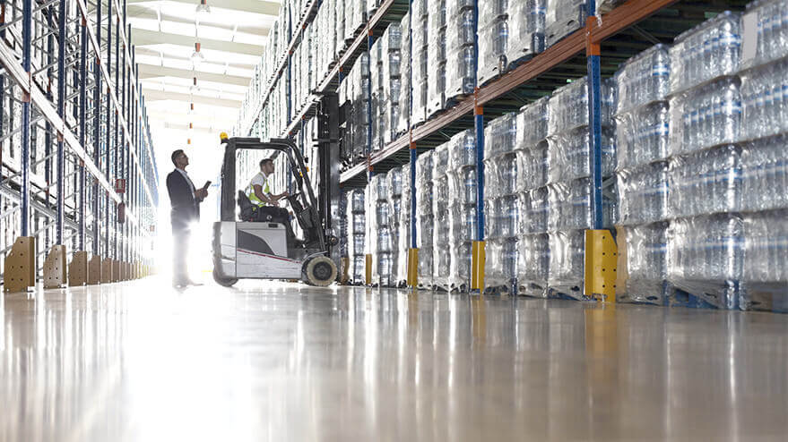 A business owner checking on product in a warehouse.