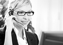 A woman wearing a headset is talking on the phone