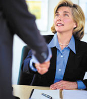 Client shaking hands with insurance professional