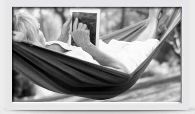 Image of woman in hammock with a tablet