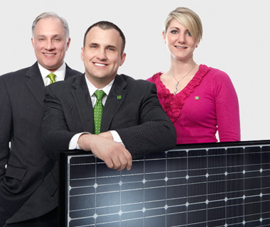 photo of TD employees holding a solar panel