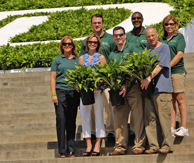 photo of TD employees holding plants