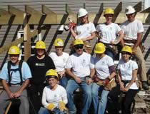 Photo of More than 60 TD employees wearing hard hats