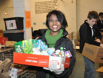Employee volunteer holding box of groceries