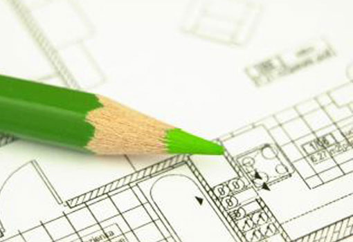 image of green pencil on building plans