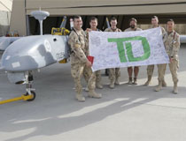 photo of troops with TD flag, Kandahar