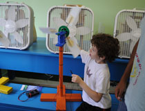 photo of young student, hands-on workshops focusing on energy conservation and renewable energy