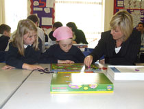 photo of TD volunteer reading to children