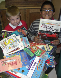 photo of children holding books