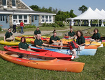 photo of TD employees sitting with donated kayaks
