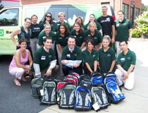 photo of TD employees, with Food Bank Backpacks