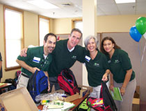 photo of TD employees, packing backpacks