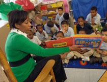 photo of TD employee reading to children