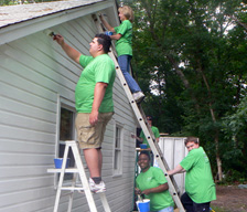 TD employees painting a house