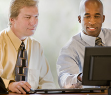 Two men viewing a webinar