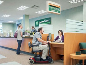 Photo of TD customer in scooter at a branch