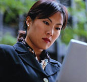 Business woman viewing online tours on a laptop